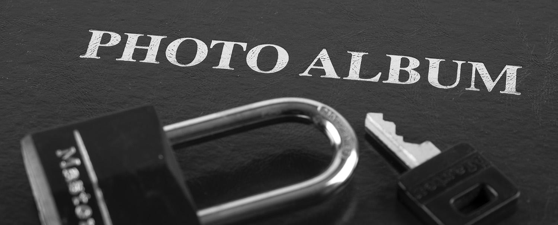 Still life of lock on photo album