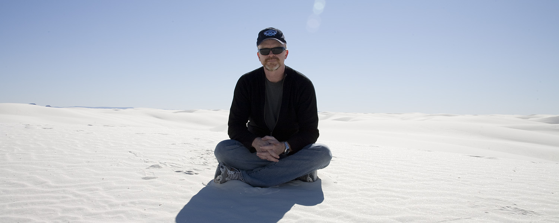 Portrait of man sitting at White Sands National Park