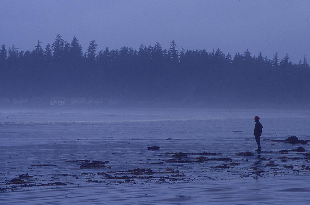 Man on beach in Tofino, BC