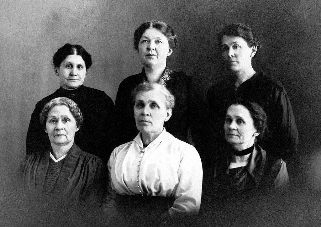 Retouched antique photo of six women