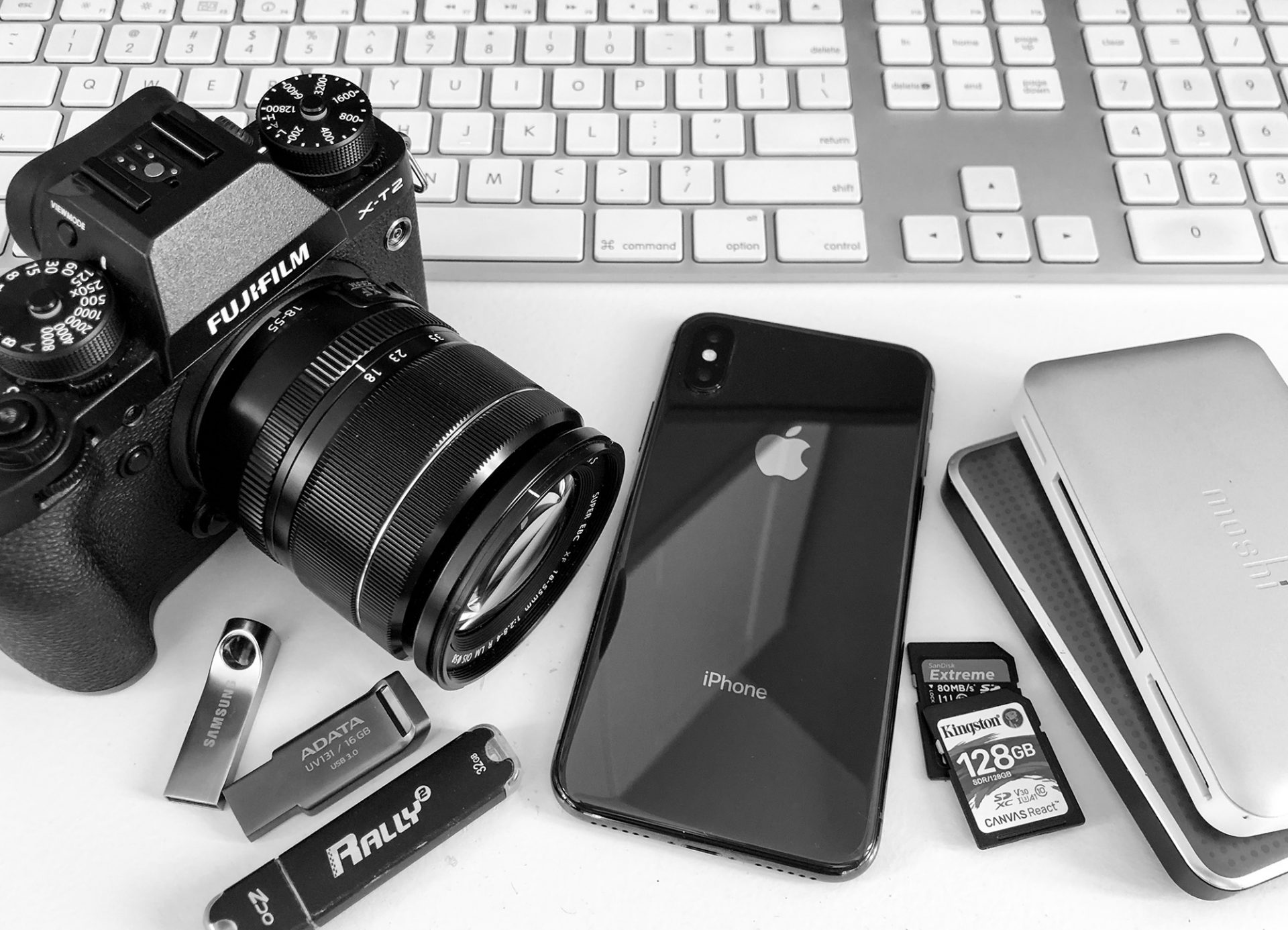Lap top with Fujifilm camera, hard drives and SD cards