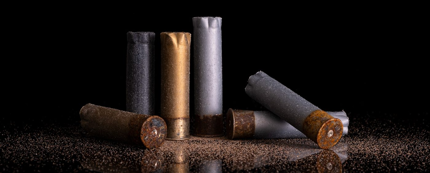 Still life of gun shot shells on reflective black background