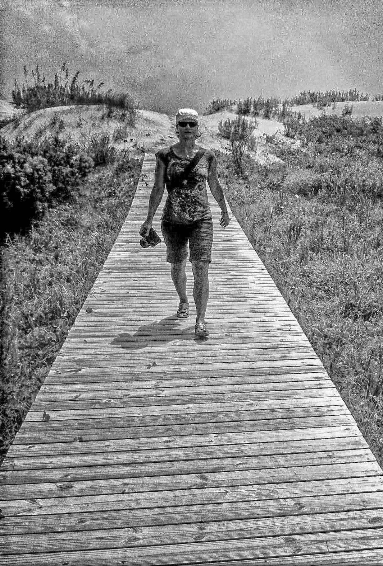 leni J photo walking with camera