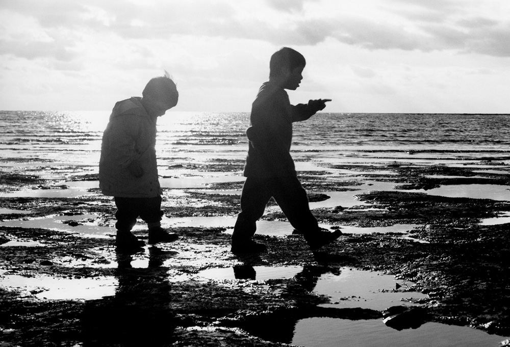 Silhouette image of young boys